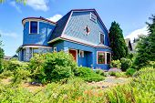 picture of red siding  - Clapboard siding house in blue color with red trim and stone wall trim - JPG