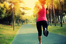 stock photo of japanese woman  - Runner athlete running at tropical park - JPG