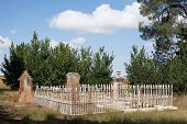 picture of burial  - Detail of section of an old cemetary with fenced burial plot - JPG