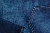 stock photo of denim jeans  - closeup detail of blue denim jeans trouses pocket texture background - JPG