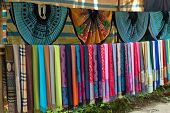 stock photo of hmong  - White Thai ethnic traditional scarf and dress in the Mai Chau village - JPG