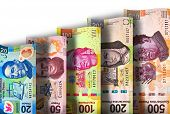 stock photo of pesos  - Mexican Peso Paper bills growing in value and size - JPG