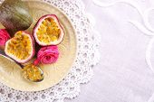picture of passion fruit  - Passion fruit on plate on color wooden background - JPG