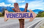 foto of canaima  - Venezuela wooden sign with road background - JPG