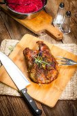 stock photo of duck breast  - Roasted duck breast on a wooden chopping board - JPG