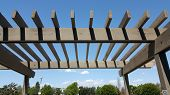 stock photo of pergola  - Portland wooden backyard pergola against blue sky - JPG