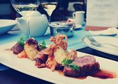 foto of duck breast  - Medium rare fried duck breast with fried onion and sauerkraut - JPG