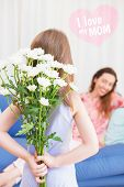 stock photo of mother daughter  - mothers day greeting against daughter surprising mother with flowers - JPG