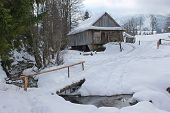 pic of barn house  - winter landscape house near the road and the bridge over the river - JPG