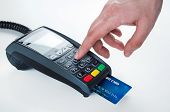 stock photo of terminator  - Hand with credit card swipe through terminal for sale - JPG