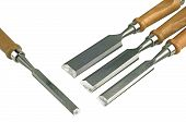 picture of chisel  - Four chisels of various widths lying on a white background - JPG