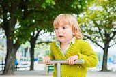 stock photo of pullovers  - Adorable toddler boy having fun on playground - JPG