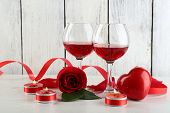 stock photo of glass heart  - Composition with red wine in glass - JPG