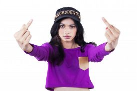 pic of middle finger  - Portrait of teenage girl with casual clothes showing two middle fingers with angry expression - JPG