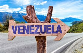 picture of canaima  - Venezuela wooden sign with road background - JPG