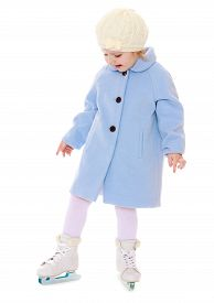 picture of little school girl  - Cute little girl in a white tracksuit standing on the ice in a blue woolen coat - JPG