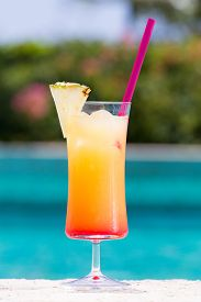 pic of cinderella  - Glass of Cinderella kids cocktail on the pool nosing at the tropical resort - JPG