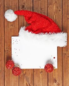image of letters to santa claus  - Letter to the Santa Claus composition of the copyspace blank sheet of paper next to multiple Christmas decorations over the wooden surface - JPG