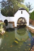 Old Refurbished Waterwheel And Watermill poster