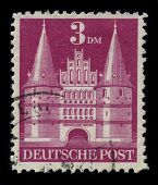 GERMANY-CIRCA 1980: A stamp shows image of the dedicated to The Holsten Gate is a city gate marking off the western boundary of the old center of the Hanseatic city of Lubeck, circa 1980.
