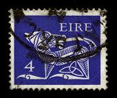 EIRE - CIRCA 1980: A stamp dedicated to The dog (Canis lupus familiaris) is a domesticated form of the gray wolf, a member of the Canidae family of the order Carnivora, circa 1980.