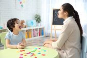 Young woman teacher and little boy on private lesson poster