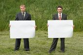 Businessmen On Green Grass Background