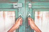 Asian Hand Holding A Metal Door Handle For Open The Ancient Wooden Slide Door. Open The Ancient Door poster