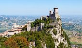 Scenic view of Guaita fortress on Monte Titano with San Marino city in background.