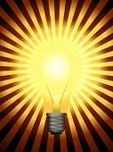 Vector - Bright and glowing light bulb with star burst effect.