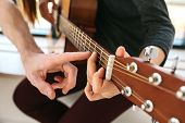 Learning To Play The Guitar. Music Education And Extra-curricular Lessons. poster