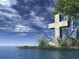 stock photo of christian cross  - stone cross at water landscape  - JPG