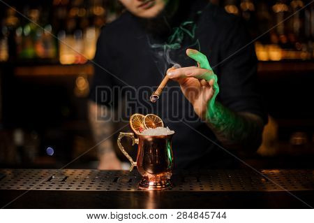 Bartender Adding To A Cocktail
