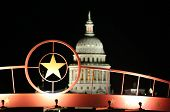 picture of capitol building  - A shot of the star of Texas with the Texas State Capitol Building in the background.