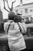 TENTERDEN, ENGLAND - DECEMBER 26: A police officer films anti hunt protestors at the Boxing Day meet
