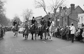 TENTERDEN, ENGLAND - DECEMBER 26: The Ashford Valley Hunt ride past anti hunt protestors in the High Street on December 26, 1992 at Tenterden, Kent. Fox hunting in England was outlawed in 2004.