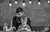Teacher With Beard, Father And Little Son In Classroom While Drawing, Creating, Chalkboard On Backgr poster