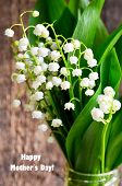 Bouquet Of Lilies Of The Valley On Old Wooden Background.lily Of The Valley Spring Flowers.concept F poster