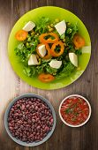 Salad Of Cheese, Lettuce, Corn, Pepper On A Wooden Background. Vegetarian Salad On A Plate. Vegetari poster