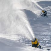 Snow Cannons Spraying Artificial Snow In Winter poster