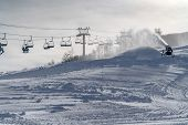 Snow Gun And Ski Lifts On A Sunny Winter In Utah poster