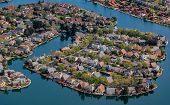 Aerial View Of Row Houses In Foster City Section On Central Lake Canals By The San Francisco Bay In  poster