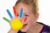 child with finger paints colors