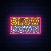 Slow Down Neon Sign Vector. Slow Down Design Template Neon Text, Light Banner, Neon Signboard, Night poster
