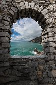 Coastline And The Mediterranean Sea. Portovenere Or Porto Venere, Panorama Seen Through A Window Wit poster