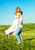 happy young loving couple having fun outdoor in summertime