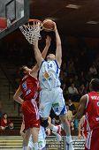 KAPOSVAR, HUNGARY - NOVEMBER 19: Jozsef Lekli (white 14) in action at a Hugarian National Championship  basketball game Kaposvar (white) vs. Paks (red) November 19, 2011 in Kaposvar, Hungary.