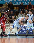 KAPOSVAR, HUNGARY - NOVEMBER 19: Nik Raivio (C) in action at a Hugarian National Championship  basketball game Kaposvar (white) vs. Paks (red) November 19, 2011 in Kaposvar, Hungary.