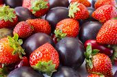 Various Fresh Summer Fruits. Ripe Strawberries And Plums. Background Fruits. Texture Fruits Close Up poster