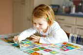 Adorable Cute Toddler Girl Playing Picture Card Game At Home Or Nursery. Happy Healthy Child Trainin poster
